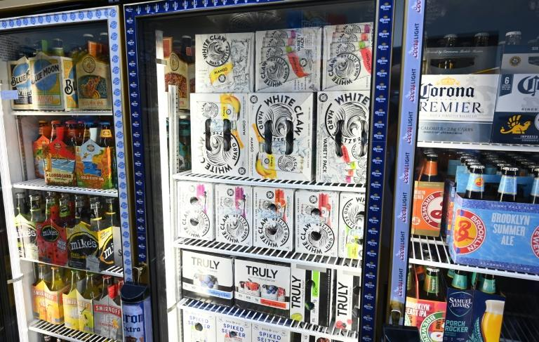 Cartons of White Claw, Truly and Bon & Viv spiked seltzer are on display at the Round The Clock Deli in New York -- the alcoholic beverage is all the rage in the United States