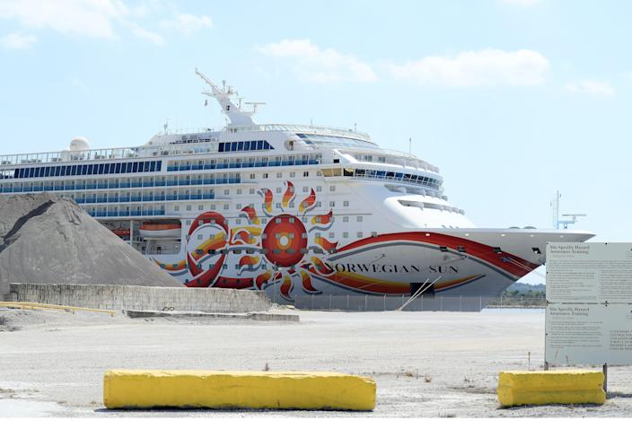 Norwegian Cruise Line Holdings Ltd. is suing Florida's surgeon general over the state's law banning vaccine passports.Here, the company's Norwegian Sun sits docked at the Port of Jacksonville on March 27, 2020.