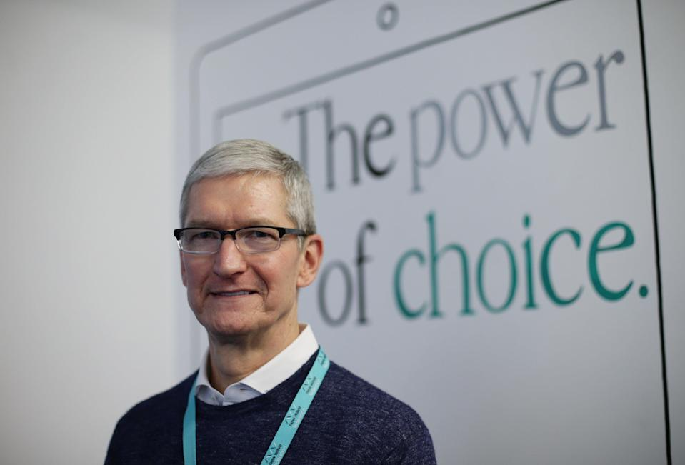 Tim Cook said staff must work in the office at least three days a week ((Yui Mok/PA))