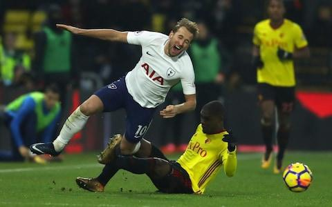 It is rare that a referee gets booed off the pitch by both sets of fans, but Martin Atkinson managed to upset the supporters of Watford and Tottenham at the end of a hard-fought draw in which the visitors had to play almost 40 minutes with ten men. Davinson Sanchez, their young Colombian centre-back was dismissed in the 53rd minute for raising his arm in the face of Richarlison as the Brazilian winger ran past him. There was no arguing with that decision, but both sides felt Atkinson had a poor game. The referee was otherwise lenient, allowing both Marvin Zeegelaar and Christian Kabasele to go unpunished for wild challenges when they were already on yellow cards. Harry Kane and Dele Alli took a lot of punishment from Watford's physical approach, and Kane looked battered and bruised as he came off at the end. Despite being reduced to ten men, Spurs had chances on the break to nick three points, and although a draw enabled them to move above Burnley into sixth place, their poor league form continues. They have now failed to win an away game in the league since September, and have only one league victory in their past six games. Harry Kane was given the rough treatement Credit: Getty images Tottenham started slowly again and were made to pay when Watford scored in the 13th minute, as Christian Kabasele headed in a corner from Tom Cleverley. Spurs had reason to feel aggrieved as Kane was caught late by Sebastian Prodl in the build-up, but referee Martin Atkinson waved play on, setting a pattern for the lenience he showed generally. Kane in particular came in for heavy challenges from Prodl, Marvin Zeegelaar and Kabasele, who received one yellow card and was somewhat fortunate not to get a second. Watford would have doubled their lead had Ben Davies not blocked a spectacular overhead shot from Richarlison, and within five minutes Spurs were level. Christian Eriksen led a quick break and when he crossed from the right, Heung Min Son was unmarked at the far post to sweep t