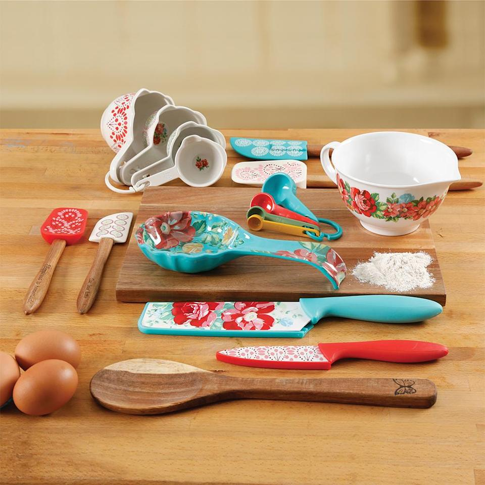 "<p>Complete a new homeowner's kitchen with these delightful, floral-patterned cooking accessories. The 20-piece set includes everything from an essential cutting board to beautifully painted measuring cups.<br><strong><a href=""https://fave.co/2QjXua8"" rel=""nofollow noopener"" target=""_blank"" data-ylk=""slk:SHOP IT"" class=""link rapid-noclick-resp"">SHOP IT</a>:</strong> $34, <a href=""https://fave.co/2QjXua8"" rel=""nofollow noopener"" target=""_blank"" data-ylk=""slk:walmart.com"" class=""link rapid-noclick-resp"">walmart.com</a> </p>"