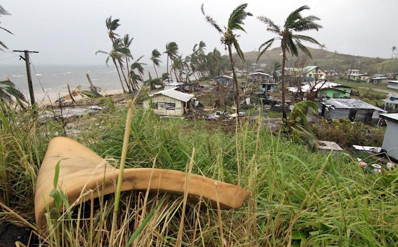 The Pacific island of Fiji is already feeling the impact of climate change through wild storms such as Cyclone Winston, which killed 44 people in 2016 and wiped out a third of the economy (AFP Photo/STEVEN SAPHORE)