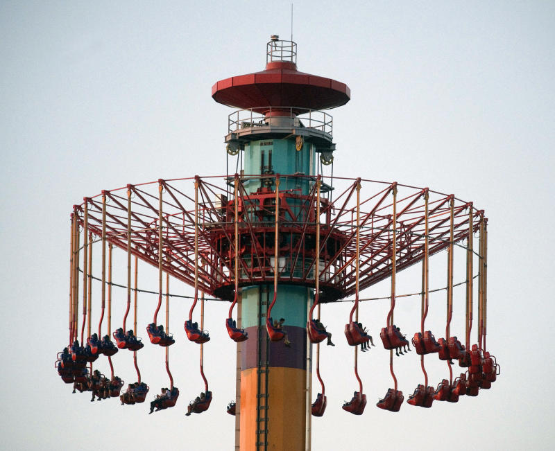 People on the Windseeker ride at Knott's Berry Farm are stuck a few hundred feet off the ground Wednesday, Sept. 19, 2012, in Buena Park, Calif. The ride held about 20 people in suspended above ground as the park's ride maintenance crews worked to get the passengers down_the riders were brought down a couple hours later and the park closed. (AP Photo/The Orange County Register, Rod Veal)  MAGS OUT; LOS ANGELES TIMES OUT