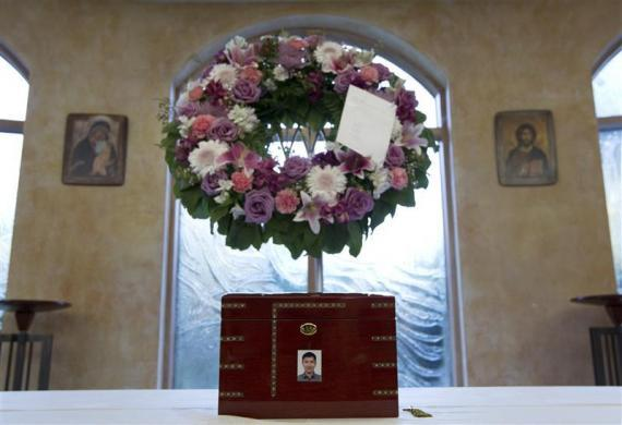 The urn containing the ashes of Jun Lin sits in a funeral home prior to the funeral services in Montreal, July 26, 2012. According to the police, Porn Actor Luka Magnotta murdered Lin, dismembered his body and posted a gory video of the crime online. Magnotta faces first degree murder charges.