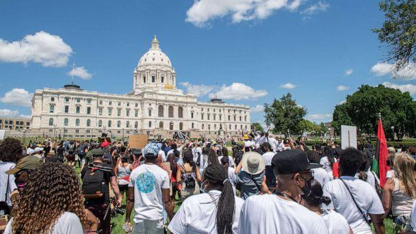 PHOTO: Marchers walk on the lawn of the State Capitol during a National Mother's March in St. Paul, Minn., July 12, 2020. (Amanda Sabga/AFP via Getty Images)