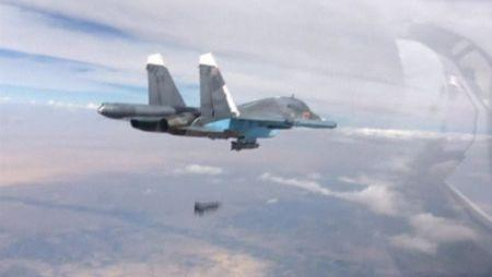 A frame grab taken from footage released by Russia's Defence Ministry October 9, 2015, shows a Russian Su-34 fighter-bomber dropping a bomb in the air over Syria. REUTERS/Ministry of Defence of the Russian Federation/Handout via Reuters