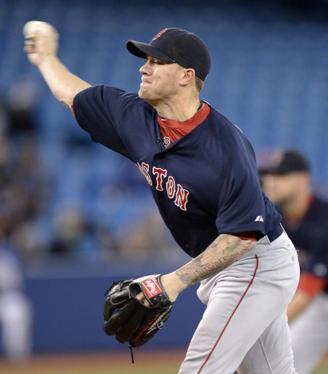 Boston Red Sox starting pitcherJake Peavy works against the Toronto Blue Jays during the first inning of a baseball game in Toronto on Friday, April 25, 2014. (AP Photo/The Canadian Press, Frank Gunn)
