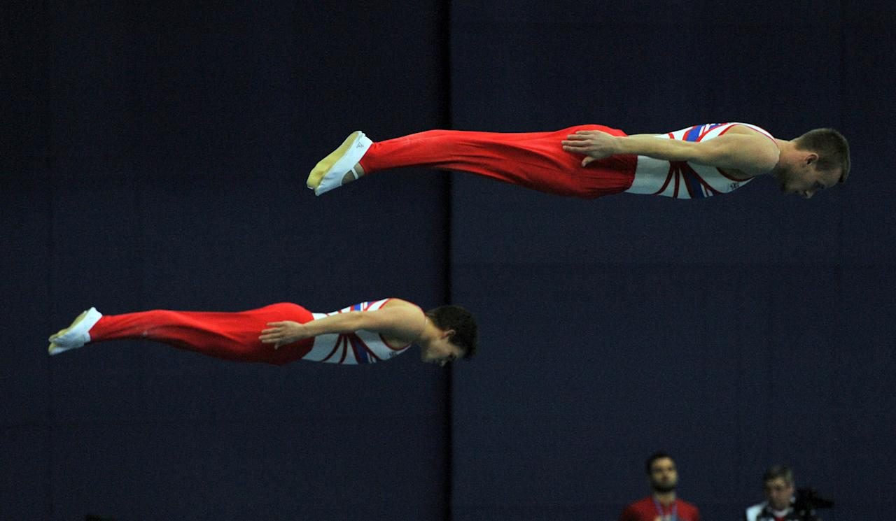 Gymnasts perform during the 23rd European Trampoline championships in St. Petersburg, on April 11, 2012. AFP PHOTO / OLGA MALTSEVA (Photo credit should read OLGA MALTSEVA/AFP/Getty Images)