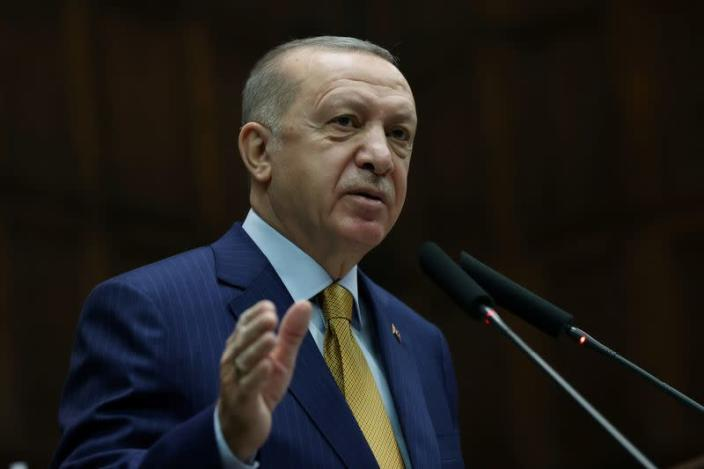 FILE PHOTO: Turkish President Erdogan addresses members of his ruling AK Party during a meeting at the parliament in Ankara