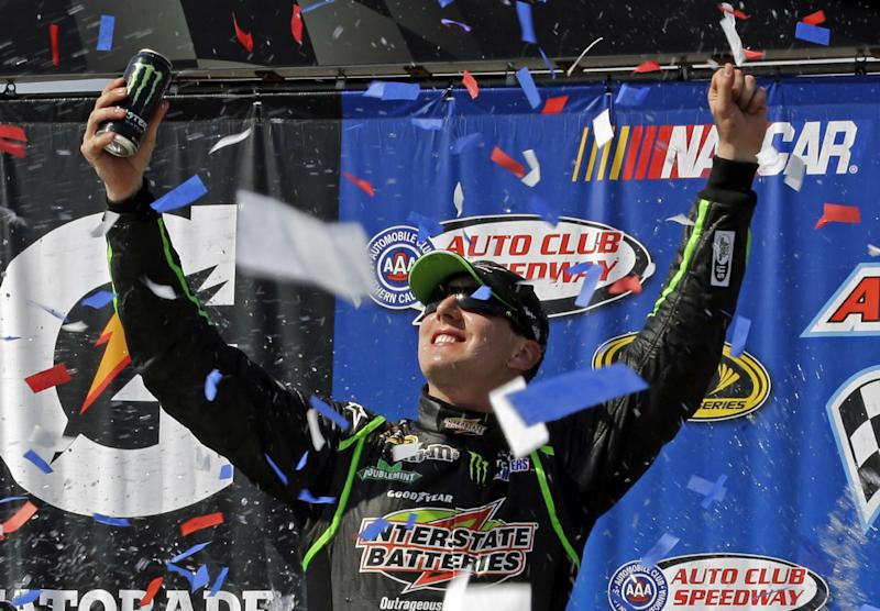 Kyle Busch celebrates his win in the NASCAR Sprint Cup Series auto race in Fontana, Calif., Sunday, March 24, 2013. (AP Photo/Reed Saxon)