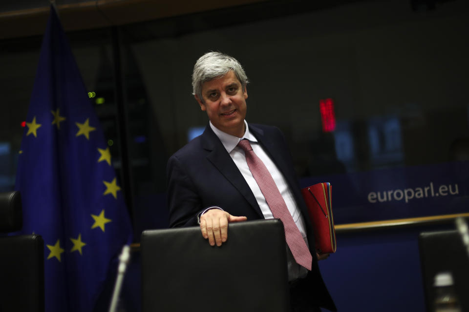Eurogroup President Mario Centeno arrives to a Committee on Economic and Monetary Affairs at the European Parliament in Brussels, Monday, Nov. 18, 2019. (AP Photo/Francisco Seco)