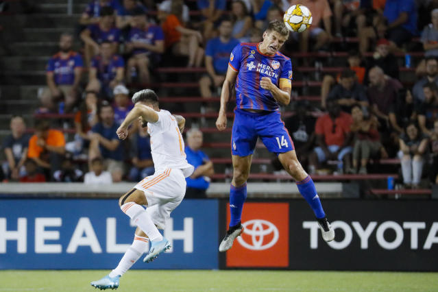 FC Cincinnati defender Nick Hagglund (14) beats Atlanta United forward Hector Villalba, left, to the ball in the second half of an MLS soccer match, Wednesday, Sept. 18, 2019, in Cincinnati. (AP Photo/John Minchillo)