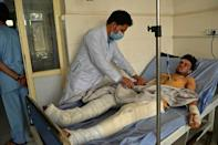 A doctor attends to a man injured in October 8 suicide bombing at the Gozar-e-Sayed mosque (AFP/Hoshang Hashimi)