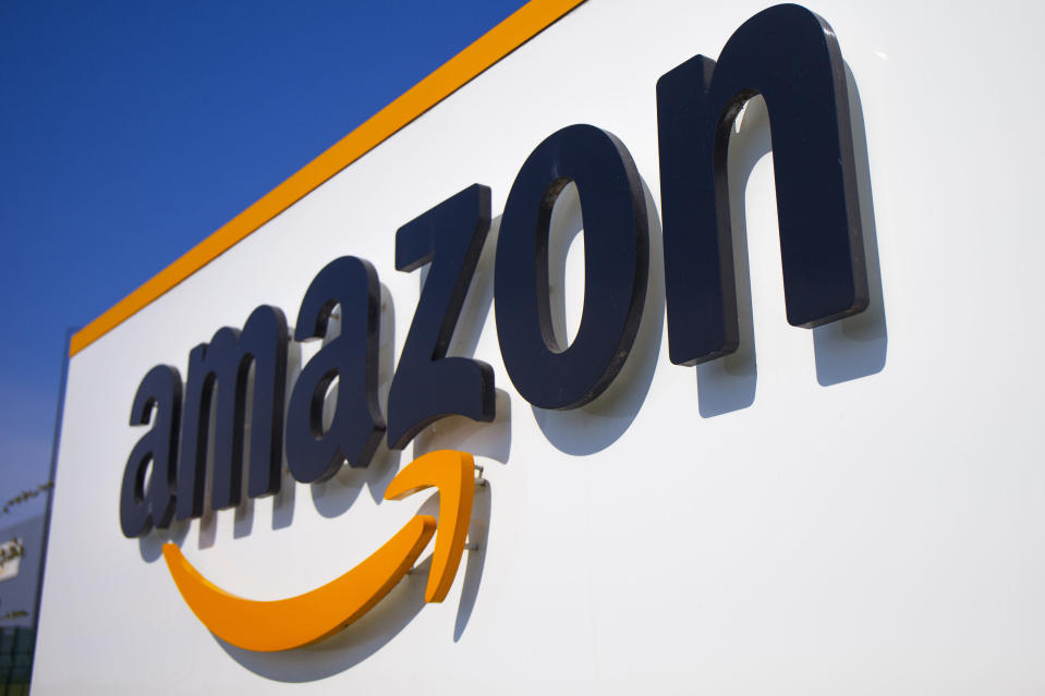FILE - In this Thursday April 16, 2020 file photo, The Amazon logo is seen in Douai, northern France. Amazon is looking to kickstart holiday shopping early this year. The company said Monday, Sept. 28, 2020 that it will hold its annual Prime Day sales event over two days in October That's because the pandemic forced it to be postponed from July. It's the first time the sales event is being held in the fall. (AP Photo/Michel Spingler, File)