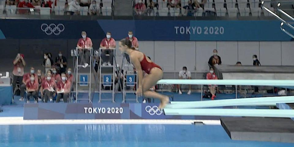 Screeshot shows Pamela Ware diving into the pool at the Tokyo Olympics