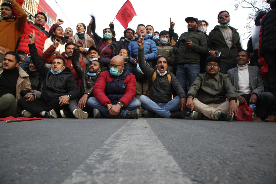 Nepalese students affiliated with Nepal Student Union chant slogans against prime minister Khadga Prasad Oli during a protest in Kathmandu, Nepal, Sunday, Dec. 20, 2020. Nepal's president dissolved Parliament on Sunday after the prime minister recommended the move amid an escalating feud within his Communist Party that is likely to push the Himalayan nation into a political crisis. Parliamentary elections will be held on April 30 and May 10, according to a statement from President Bidya Devi Bhandari's office. (AP Photo/Niranjan Shrestha)