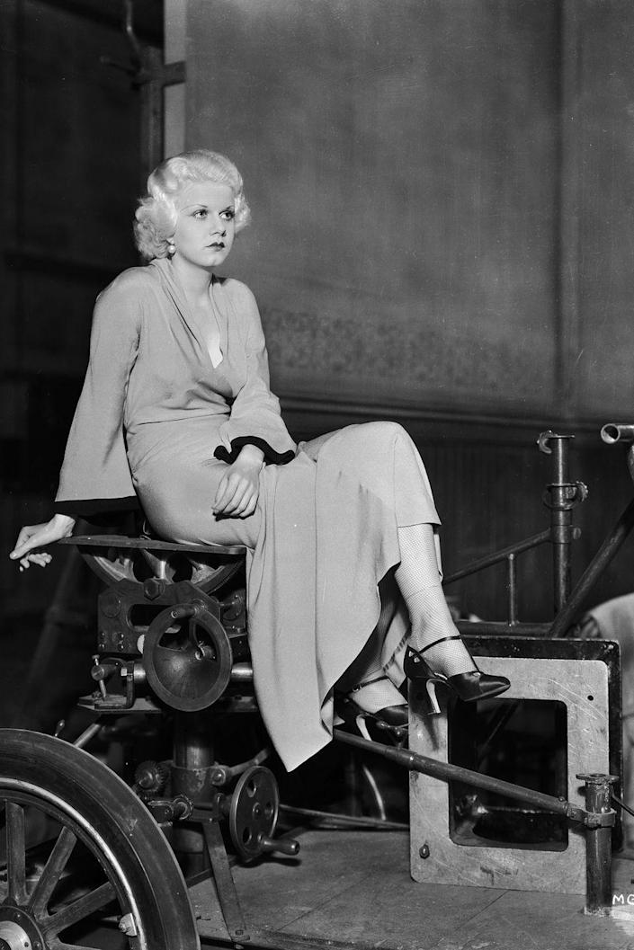 <p>Jean Harlow rests on a dolly between shots on the set of <em>The </em><em>Beast of the City. </em></p>