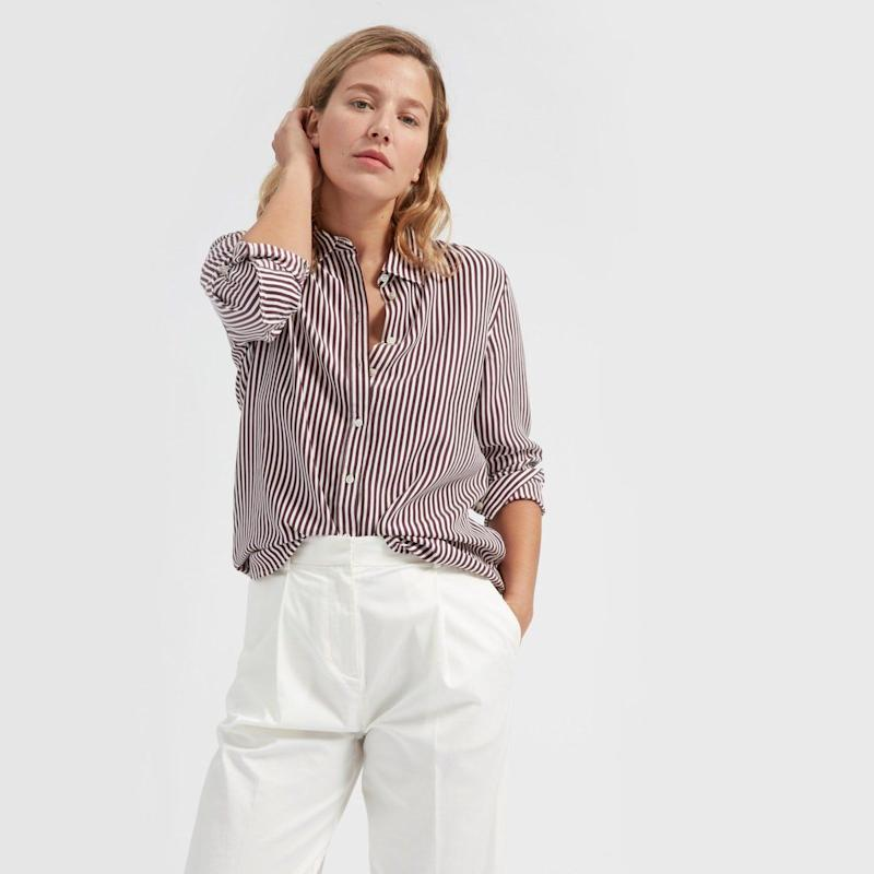 """Get it at <a href=""""https://www.everlane.com/products/womens-relaxed-silk-shirt-burgundy-bone?collection=womens-bestsellersv2"""" target=""""_blank"""">Everlane</a>."""