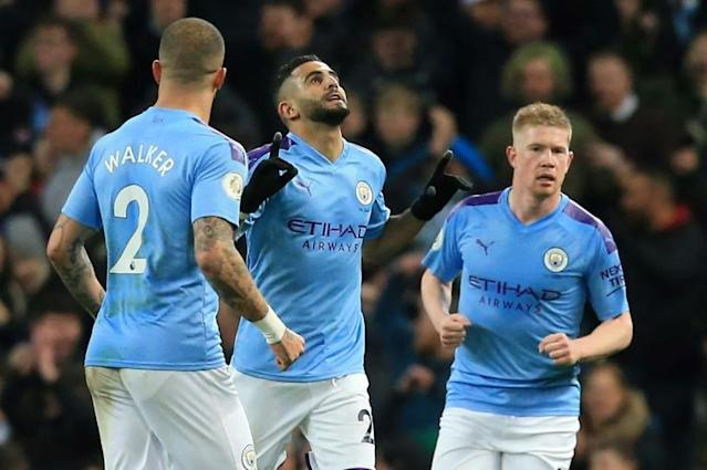 Manchester City's Riyad Mahrez (C) celebrates scoring in the win against Leicester (AFP Photo/Lindsey Parnaby)