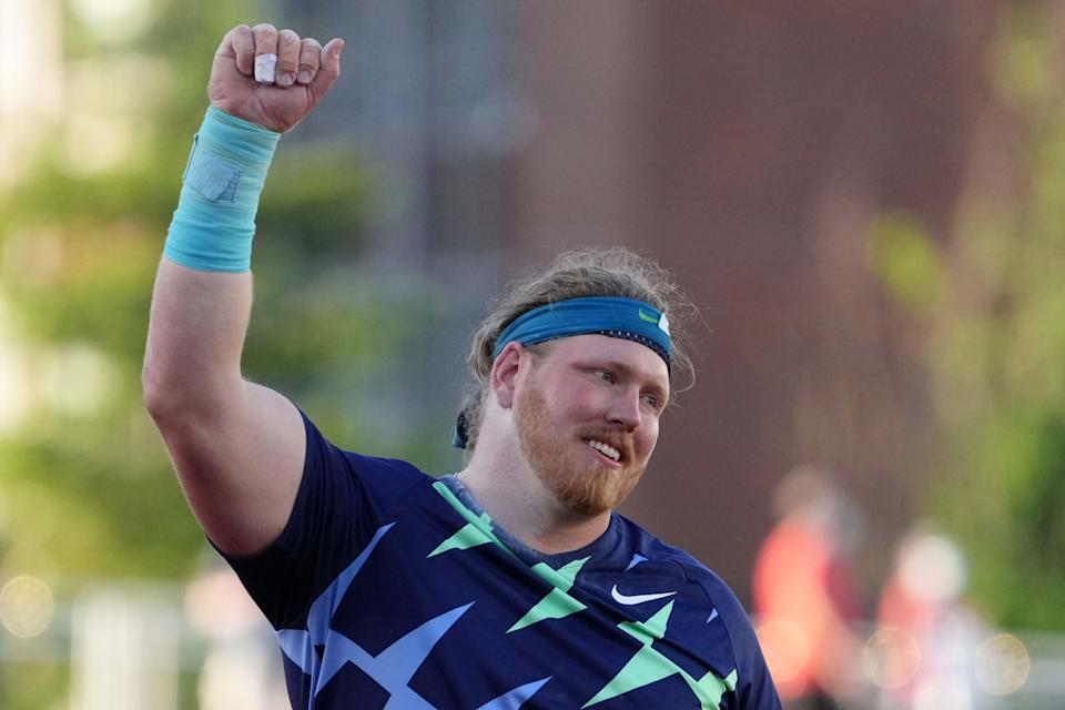 Ryan Crouser celebrates after winning the shot put in a world record 76-8 1/4 (23.37) during the US Olympic Team Trials at Hayward Field.