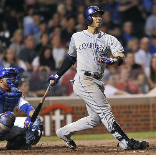 Colorado Rockies' Carlos Gonzalez watches his solo home run during the eighth inning of a baseball game against the Chicago Cubs in Chicago, Tuesday, May 14, 2013. (AP Photo/Paul Beaty)