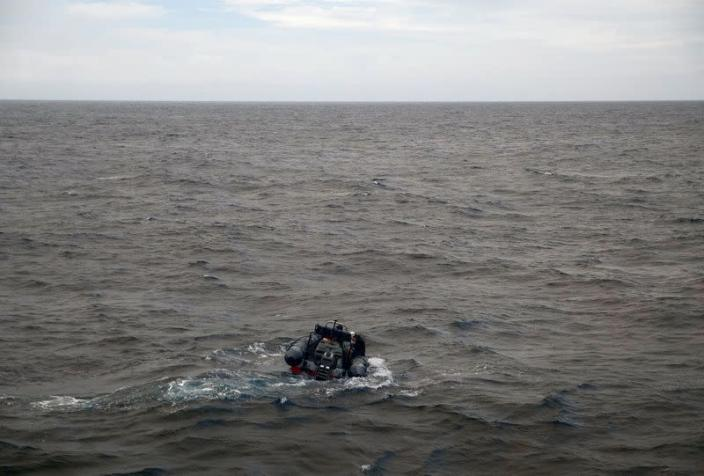 Arctic Sunrise ship crew members are seen on a rigid inflatable boat as they check for the depth in the Indian Ocean at the Saya de Malha Bank