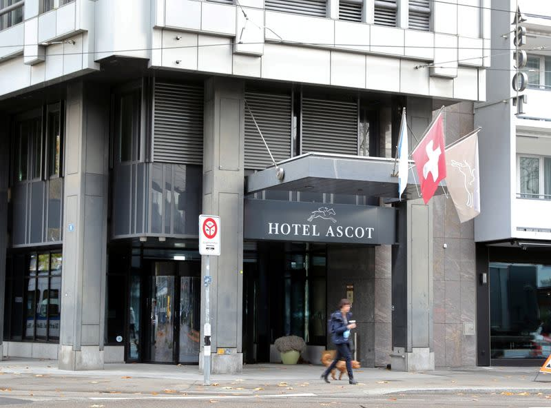 A person walks past the entrance of the closed Hotel Ascot in Zurich