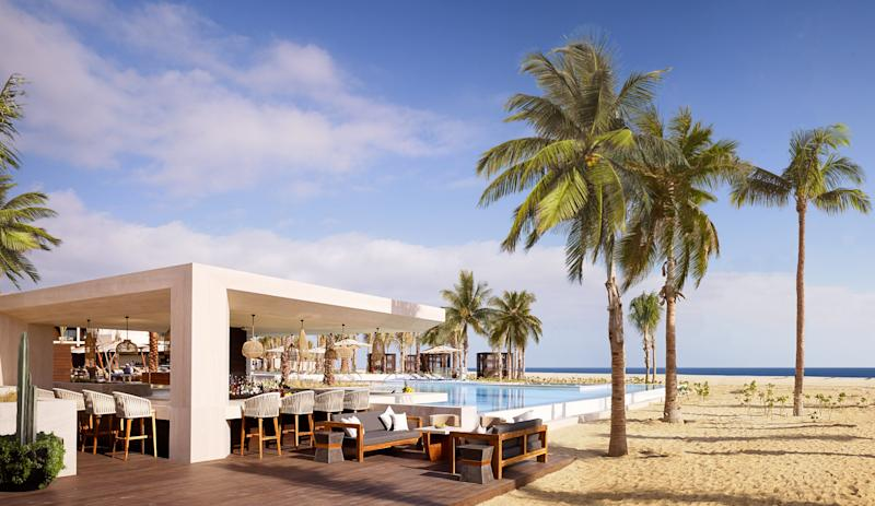 At the Los Cabos location, the hotel's swim-up bar allows guests to grab a cocktail without ever leaving the pool.