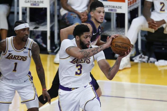 LOS ANGELES, CA - MAY 09: Los Angeles Lakers forward Anthony Davis (3) grabs a rebound against the Phoenix Suns.