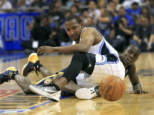 Orlando Magic's Chris Duhon, left, and Indiana Pacers' Darren Collison scramble for a loose ball during the first half of Game 4 of an NBA first-round playoff basketball series, Saturday, May 5, 2012, in Orlando, Fla. (AP Photo/John Raoux)
