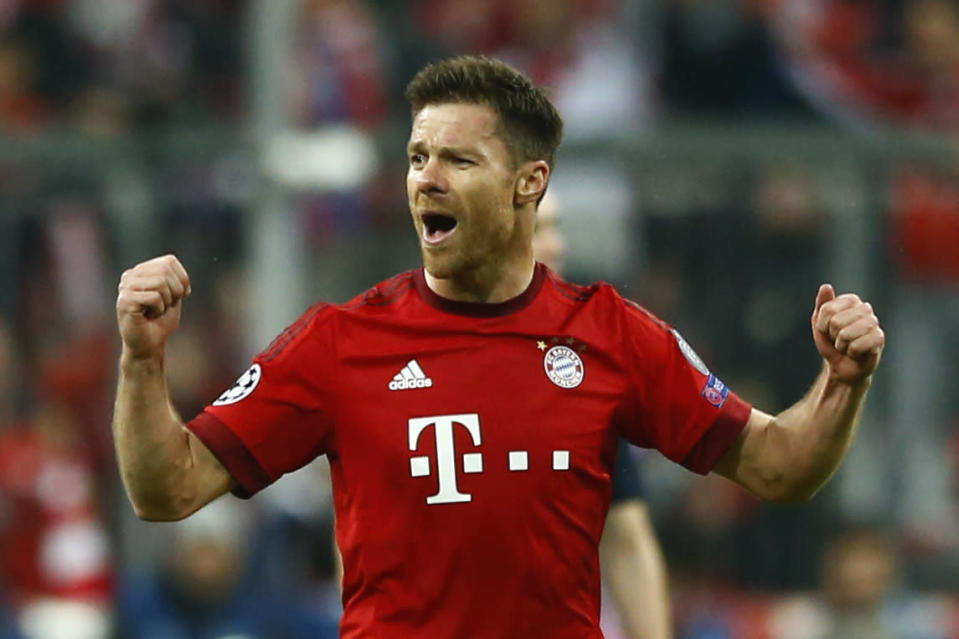 FILE - In this May 3, 2016 file photo Bayern's Xabi Alonso celebrates scoring the opening goal during the Champions League second leg semifinal soccer match between Bayern Munich and Atletico de Madrid in Munich, Germany. German media reports say that former Spain midfielder Xabi Alonso is to take over at Borussia Moenchengladbach coach next season. The tabloid Bild and its sister magazine Sport Bild first reported that the 39-year-old Alonso has agreed to take over from current Gladbach coach Marco Rose, who is joining Borussia Dortmund next season. (AP Photo/Matthias Schrader, file)