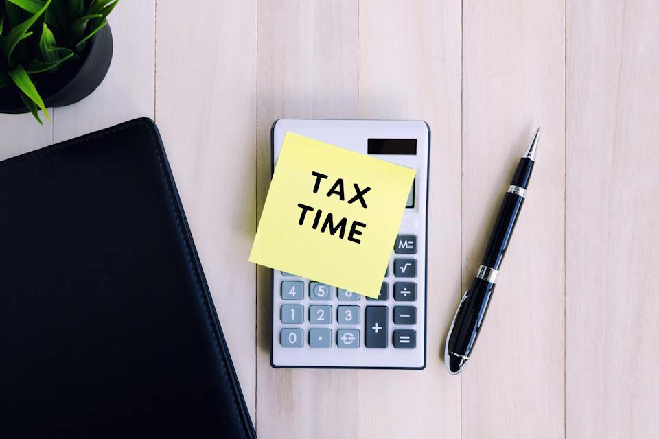Tax Time text on adhesive note on top of calculator. Source: Getty Images