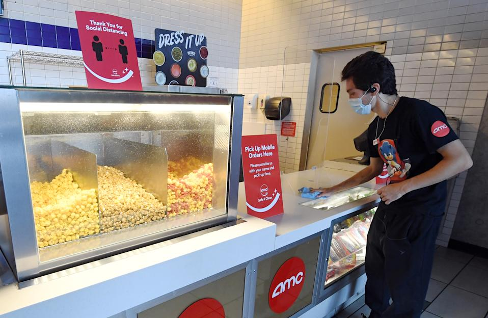 LAS VEGAS, NEVADA - AUGUST 20: Joey Walsh sanitizes the concession stand at AMC Town Square 18 on August 20, 2020 in Las Vegas, Nevada.