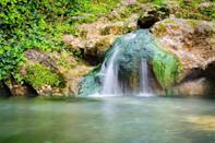 """<p><a href=""""https://www.nps.gov/hosp/index.htm"""" rel=""""nofollow noopener"""" target=""""_blank"""" data-ylk=""""slk:Hot Springs National Park"""" class=""""link rapid-noclick-resp""""><strong>Hot Springs National Park</strong></a></p><p>Located in the town of Hot Springs, this naturally beautiful park is on the map as a former tourist destination for its famed bathhouses. These buildings took advantage of the thermal springs, and were built above them. You can't hop in a spring, but you can book a visit to one of the two spas that are still operational today. </p>"""