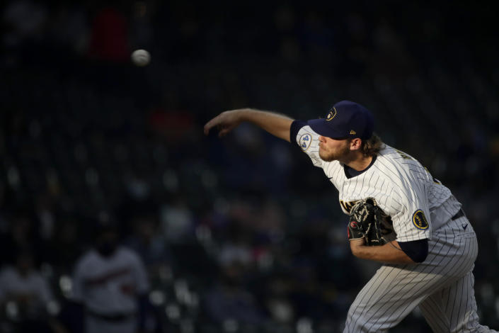 Milwaukee Brewers' Corbin Burnes pitches during the first inning of a baseball game against the Minnesota Twins, Saturday, April 3, 2021, in Milwaukee. (AP Photo/Aaron Gash)