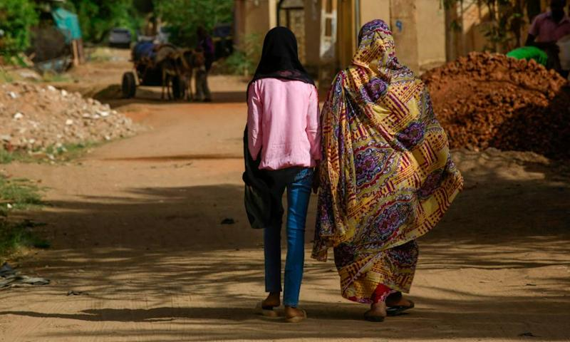 A girl and a woman walk