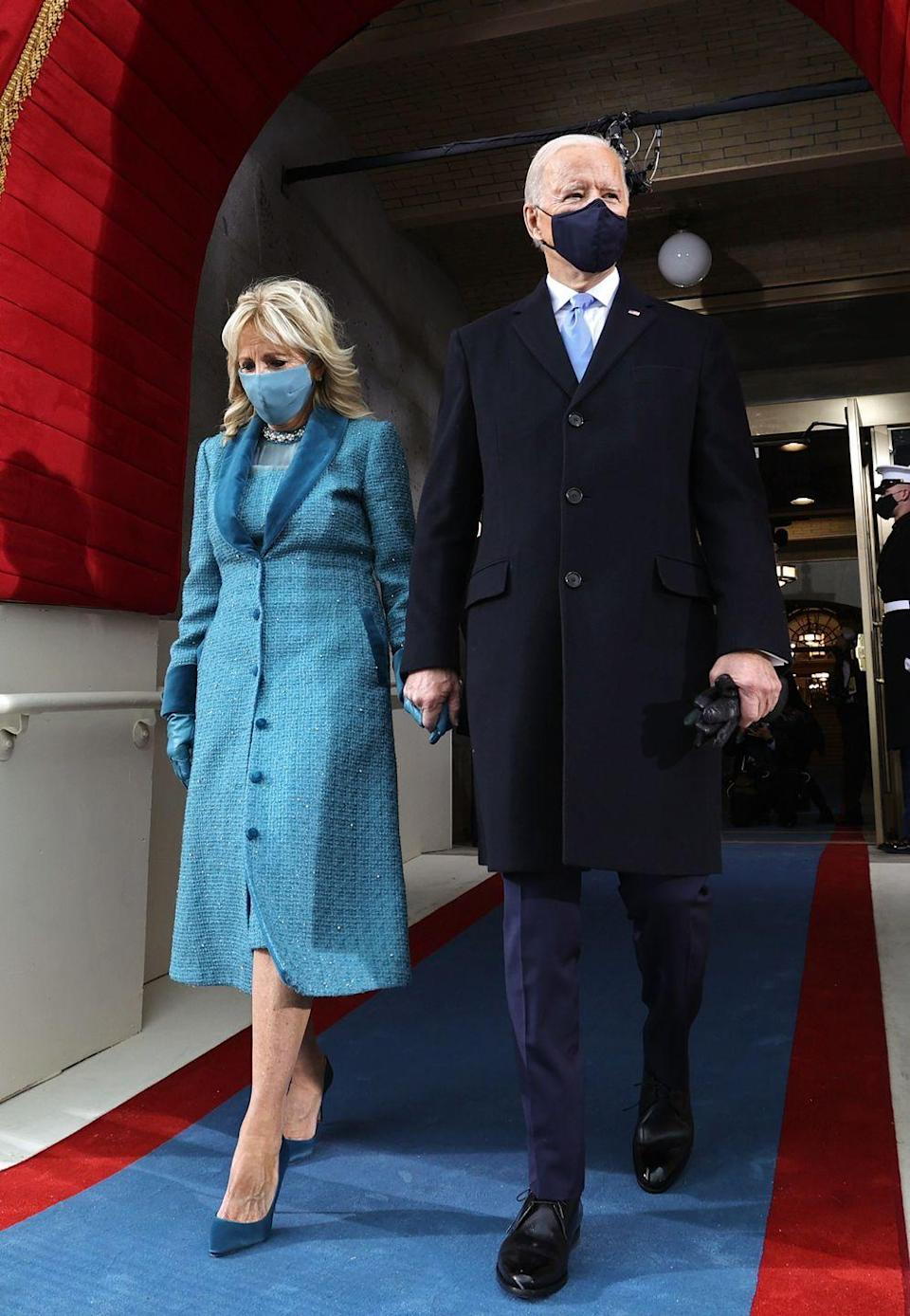 """<p>For the inauguration ceremony and the events that followed—including a visit to Arlington National Cemetery, a parade, and, finally, entering the White House for the first time as First Lady—<a href=""""https://www.townandcountrymag.com/society/politics/a35269485/jill-biden-markarian-blue-dress-inauguration-meaning/"""" rel=""""nofollow noopener"""" target=""""_blank"""" data-ylk=""""slk:Dr. Jill Biden wore a custom dress and overcoat by Markarian"""" class=""""link rapid-noclick-resp"""">Dr. Jill Biden wore a custom dress and overcoat by Markarian</a>. The New York-based label from designer Alexandra O'Neill operates with a waste-reducing made-to-order model, and proudly manufactures its wares in the city's Garment District. In a press release, the brand revealed that the color blue was chosen to """"signify trust, confidence, and stability.""""</p>"""