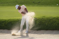 Jason Day hits from a bunker on the ninth fairway during the second round of the Travelers Championship golf tournament at TPC River Highlands, Friday, June 25, 2021, in Cromwell, Conn. (AP Photo/John Minchillo)