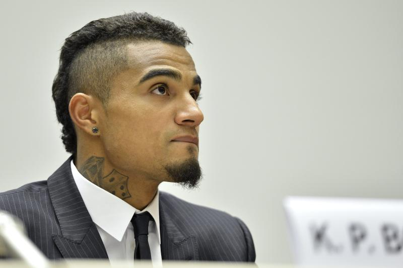 "Ghana's Kevin-Prince Boateng, soccer player of AC Milan speaks at a panel discussion on Racism and Sport during the World Humanitarian Day at the European headquarters of the United Nations in Geneva, Switzerland, Thursday, March 21, 2013. The Office of the High Commissioner for Human Rights will host a panel discussion on ""Racism and Sport"". (AP Photo/Keystone/Martial Trezzini)"