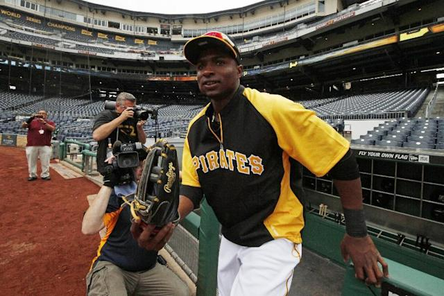 Pittsburgh Pirates' Gregory Polanco takes the field for warm ups before a baseball game against the Chicago Cubs in Pittsburgh Tuesday, June 10, 2014. It will be Polanco's Major League debut. (AP Photo/Gene J. Puskar)