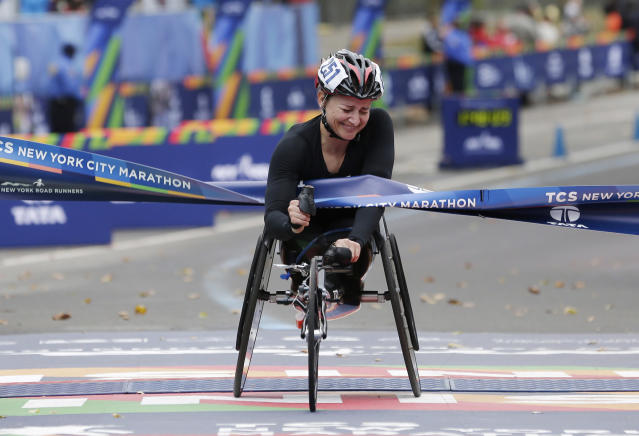 <p>Manuela Schar of Switzerland crosses the finish line first in the women's wheelchair division of the New York City Marathon in New York, Sunday, Nov. 5, 2017. (Photo: Seth Wenig/AP) </p>