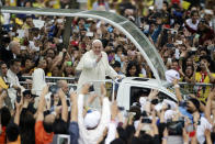 FILE - In this Jan. 18, 2015, file photo, crowds cheer as Pope Francis passes by during his meeting with the youth at the University of Santo Tomas in Manila, Philippines. Across the globe, Pope Francis' comments endorsing same-sex civil unions were received by some as encouragement for an advancing struggle and condemned by others as an earth-shaking departure from church doctrine. (AP Photo/Aaron Favila, File)