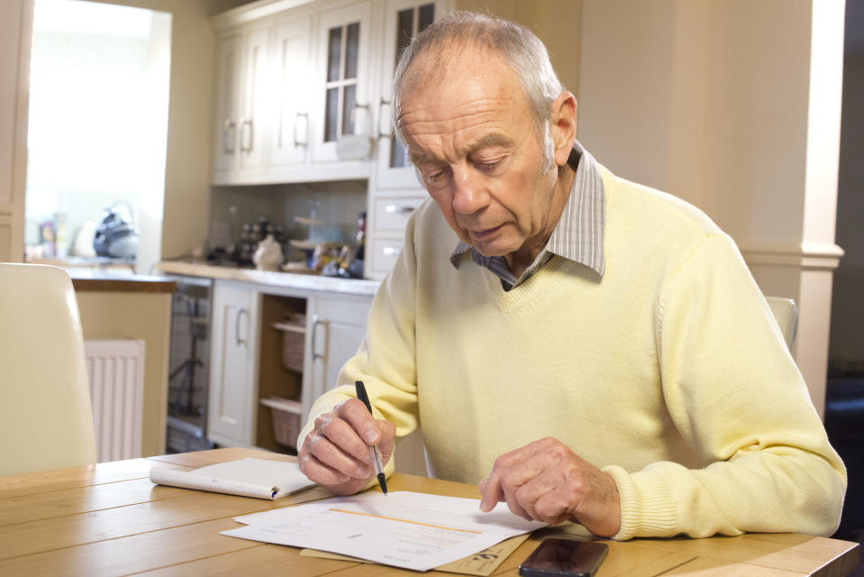 senior male with paperwork