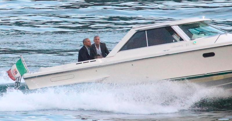 Former President Barack Obama, left, and George Clooney on a boat June 23, 2019.