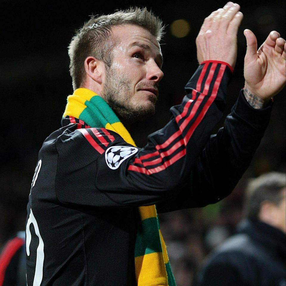 David Beckham sports the yellow and green scarf in 2010 - PA