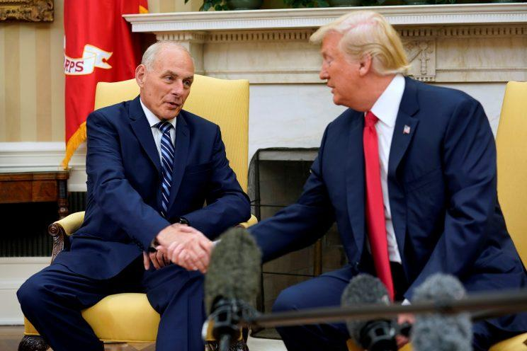 President Trump shakes hands with John Kelly after he was sworn in as White House chief of staff in the Oval Office of the White House in Washington, D.C., on July 31, 2017. (Photo: Reuters/Joshua Roberts)
