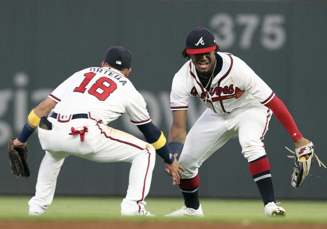 Atlanta Braves outfielders Ronald Acuna Jr., right, and Rafael Ortega celebrate after their win over the Washington Nationals in a baseball game Saturday, Sept. 7, 2019, in Atlanta. (AP Photo/Tami Chappell)