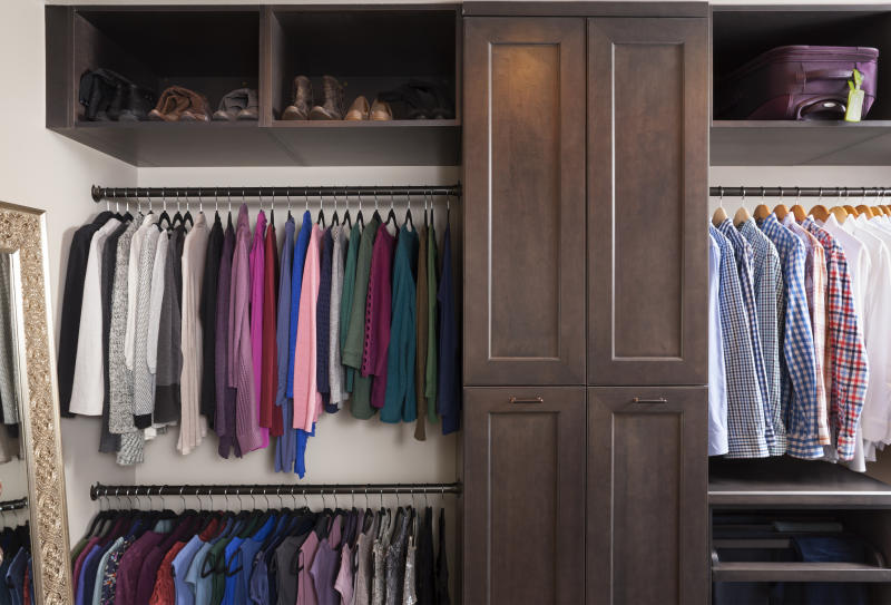 This photo provided by Case Design shows a closet designed by Elena Eskandari, an interior designer specialist at Case Design. As you plan out a walk-in closet, consider the size of the items you'll be hanging. This closet pictured has two levels of hanging space which offers room for a large collection of shirts and blouses. (Stacy Zarin Goldberg/Case Design via AP)