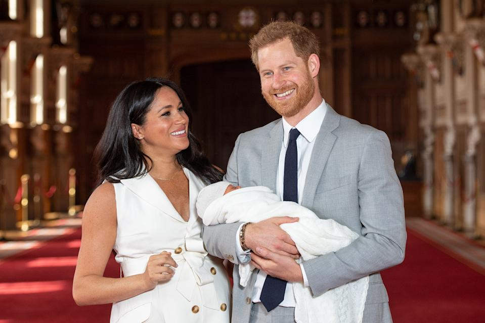 Meghan Markle and Prince Harry with their son, Archie, during a photocall in St George's Hall at Windsor Castle in Berkshire [Photo: PA]
