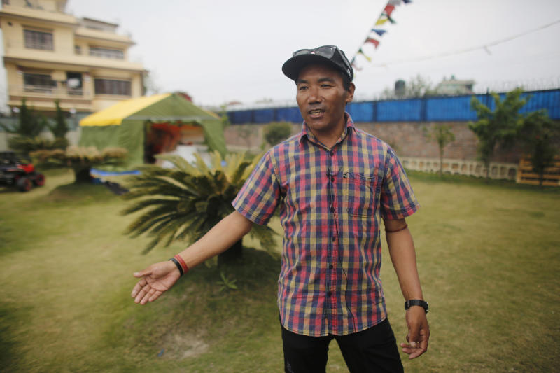 In this April 4, 2019 photo, record holding Sherpa guide Kami Rita speaks with the Associated Press in Kathmandu, Nepal. Five years after one of the deadliest disasters on Mount Everest, three people from Nepal's ethnic Sherpa community, including Rita, are preparing an ascent to raise awareness about the Nepalese mountain guides who make it possible for hundreds of foreign climbers to scale the mountain and survive. Rita, who lived through the 2014 ice avalanche on Everest's western shoulder that killed 16 fellow Sherpa guides, aims to break his own record by reaching the mountaintop a 23rd time this spring. (AP Photo/Niranjan Shrestha)
